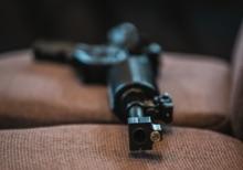 Gun on Chapel Chair